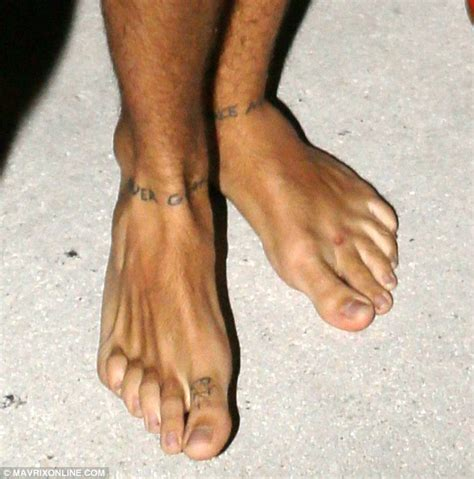 harry styles cross tattoo one direction s harry styles shows new ankle tattoos