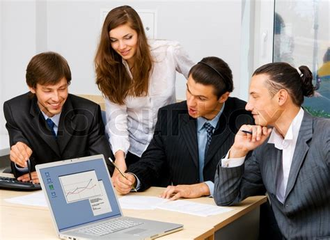 Box Office Discussion by Photo Of Office Workers A Discussion Stock Photo
