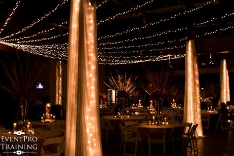 draped christmas lights red and gold wedding reception at liberty hall the