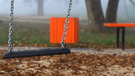 swing episode 1 empty swing set at children s playground stock footage