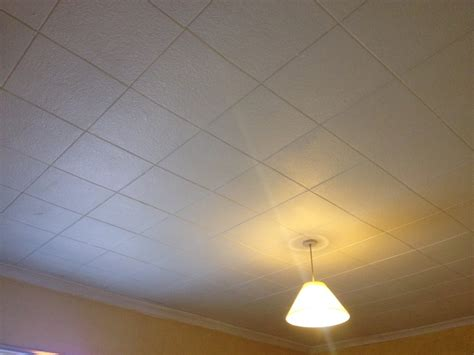 Removing Ceiling Tiles by Removal Of Polystyrene Ceiling Tiles And Skim