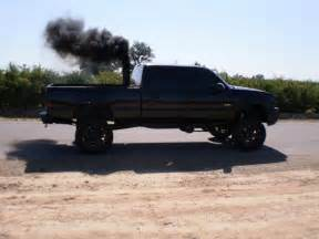 roll coal diesels trucks black lifted dodge ford