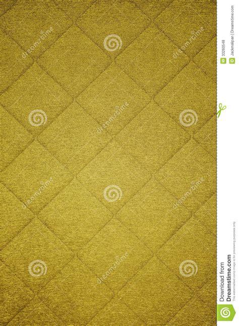 gold pattern textile shiny yellow gold pattern fabric background royalty free