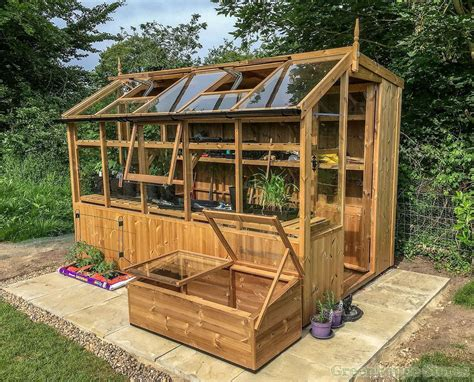 swallow jay  wooden potting shed greenhouse stores
