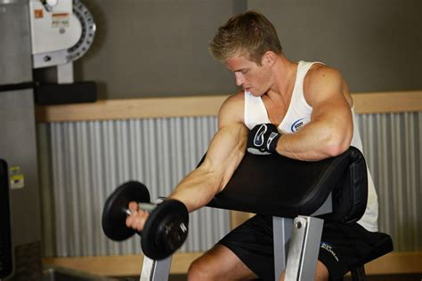 preacher bench exercises one arm dumbbell preacher curl exercise guide and video