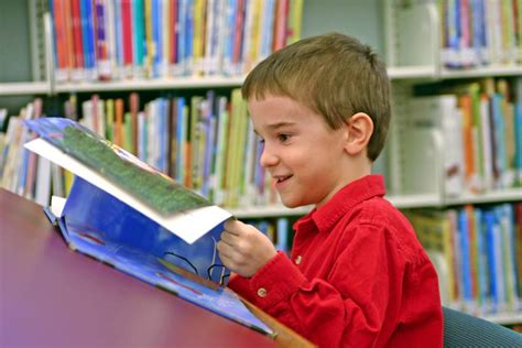 picture of a child reading a book tips for growing bookworms 3 choose books that your
