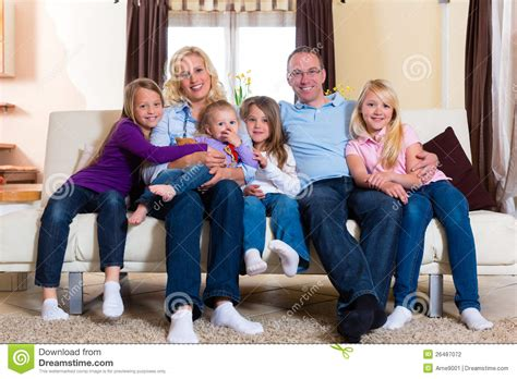 couch family family on a couch stock photography image 26487072