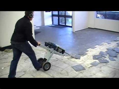 Taking Up Ceramic Floor Tiles by Makinex Jackhammer Trolley Makinex