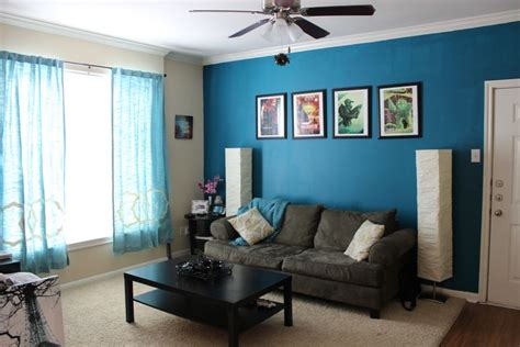 teal blue living room teal accent wall with black and brown furniture for the home blue paints