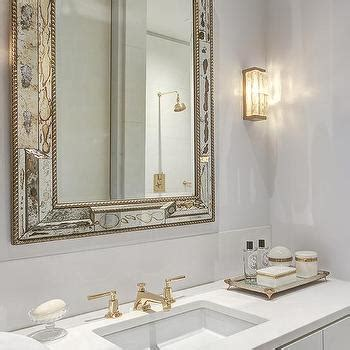 white and gold bathroom ideas antiqued mirrored bathroom vanity with white marble top