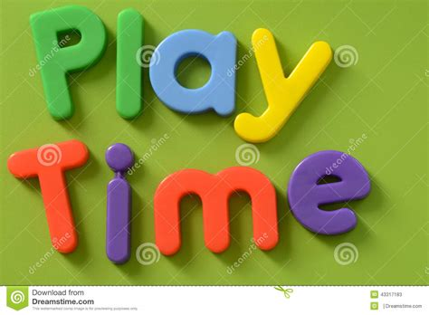 play in background up of play time words in colorful plastic le stock