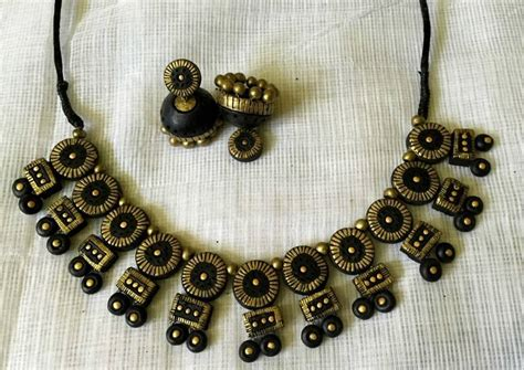 buy black and antique gold and terracotta jewellery