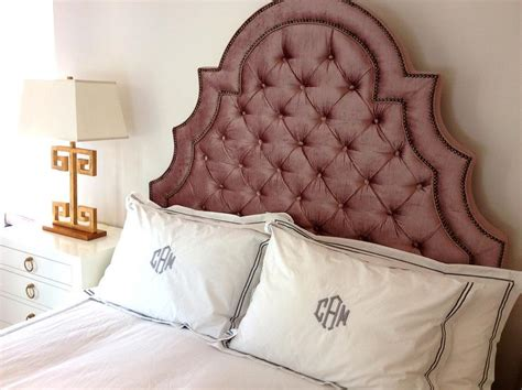 pink velvet tufted headboard with brass tacks