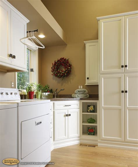 Kitchen Sink Organization Ideas - showplace cabinets laundry room traditional laundry room other by showplace wood products