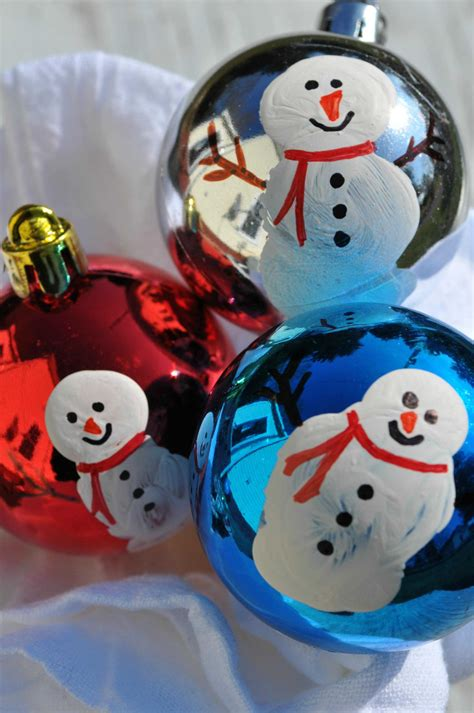 snowman decorations to make ornaments thumbprint snowmen the seasoned