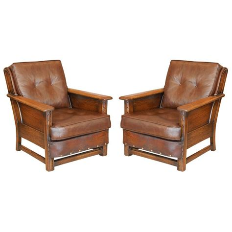 rustic leather armchair pair of wood and leather rustic chairs at 1stdibs