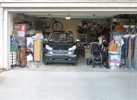 Hang Lawn Mower In Garage by Take Back Your Garage Storage Solutions Consumer Reports