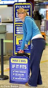 ryanair baggage size check gauge ryanair hikes luggage charges for summer as toilet tax