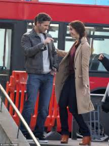 eric bana and rebecca hall have a laugh while shooting new