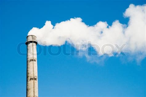 Smoke Comes Out Of Fireplace by Polluting Smoke Coming Out Of Chimney Stock Photo