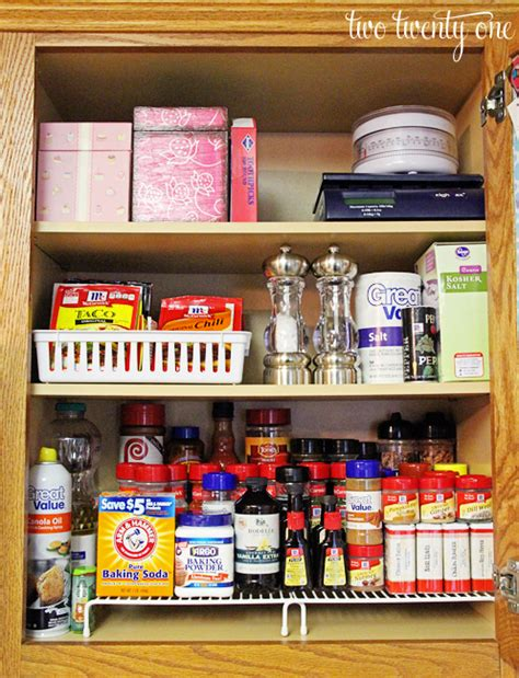 how to organize a kitchen cabinets organizing the spices two twenty one