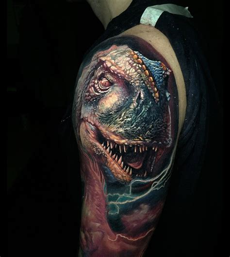 realistic t rex tattoo on guy s shoulder best tattoo