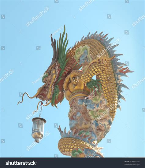 oriental design ancient chinese dragon on stock photo ancient chinese dragon statue against blue stock photo