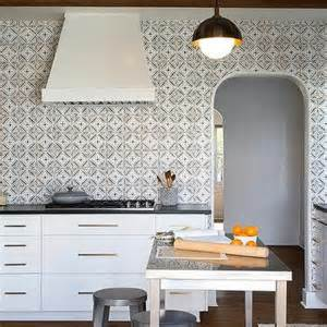 black and white kitchen with mosaic tile backsplash