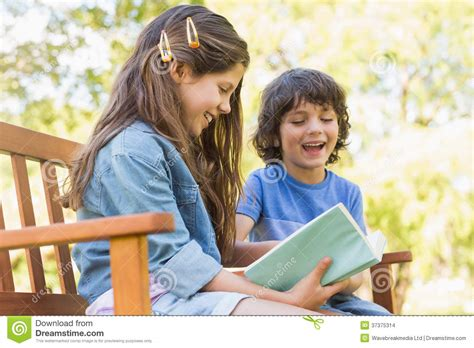 kids reading bench side view of kids reading book on park bench stock images image 37375314