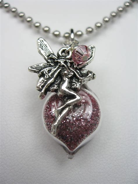 pink pixie dust necklace with charm