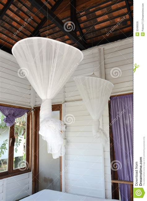 mosquito net for bedroom hanging mosquito net inside bedroom royalty free stock photo image 32490535