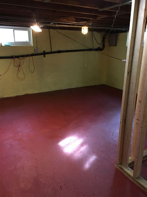 Budget fix: concrete floor primered and painted red with