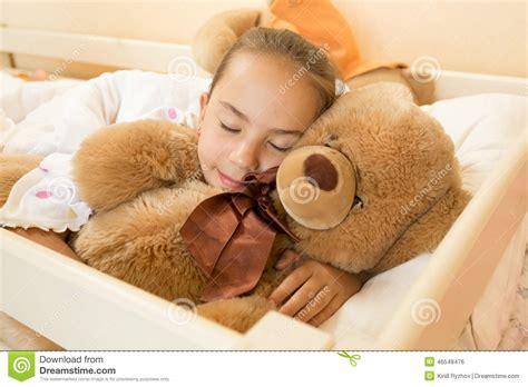 giant teddy bear bed little girl sleeping on big teddy bear at bed stock photo