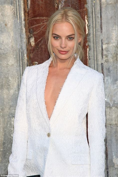 who is the actress with tarzan in the geico commercial alexander skarsgard goes shirtless with margot robbie in