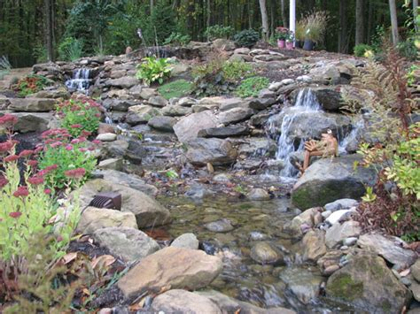 backyard streams and waterfalls klein s lawn landscaping water features pond waterfalls