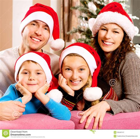 family near the christmas tree stock image image 35049747