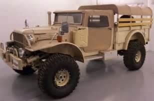 a one of a world war ii dodge power wagon sitting on