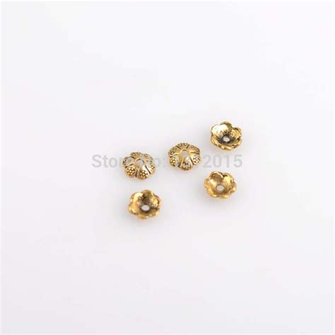 gold jewelry supplies wholesale wholesale flower torus antique gold alloy spacer