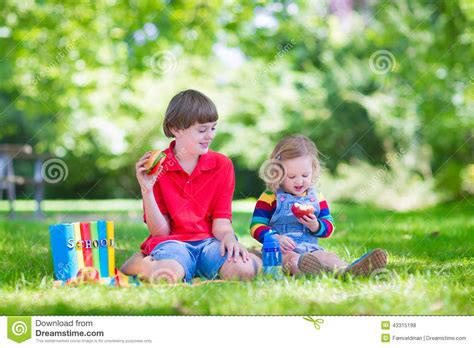 2 on becoming baby wise book two parenting your five to twelve month through the babyhood transition two reading in summer garden stock image