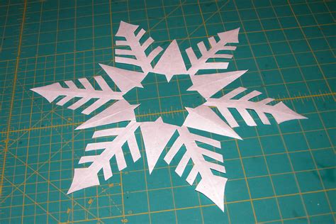 Folded Paper Cut Out Patterns - folded snowflake patterns www imgkid the image kid