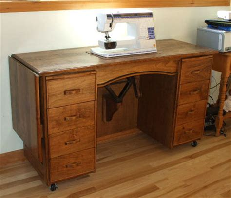 sewing machine cabinet with lift car jack sewing machine lift a smart solution for a