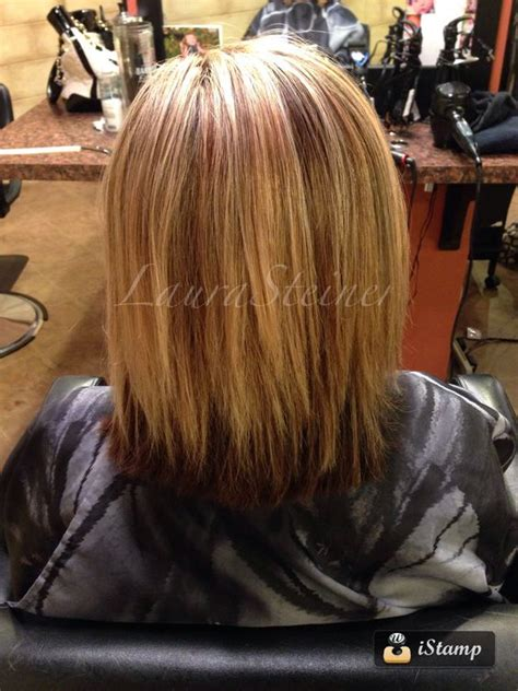 highlights with lowlights underneath mid length haircut with blended layers highlights and