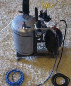 silent air compressor constructed from a refrigerator compressor an air tank and a