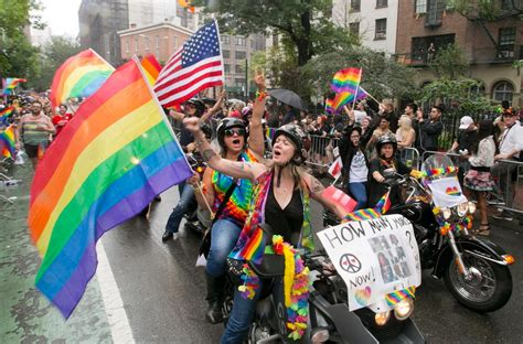 new year 2018 nyc parade motorcyclists carry flags photos pride march in