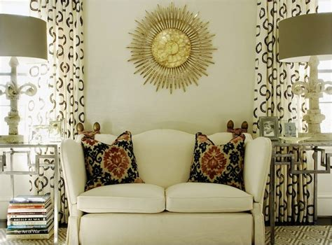 gold walls living room white sunburst mirror transitional living room architectural digest