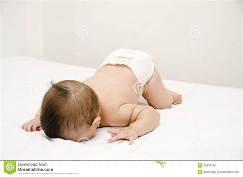 laying in bed in spanish cute baby face down royalty free stock photo image