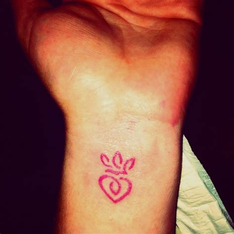 loyalty tattoo on face hearts and crown left side of your with facing
