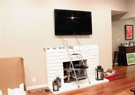 Where To Put Cable Box With Tv Fireplace by Tv Above Fireplace Paint Design