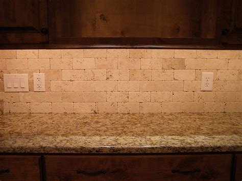 backsplash without grout ivory tumbled travertine without grout flickr photo