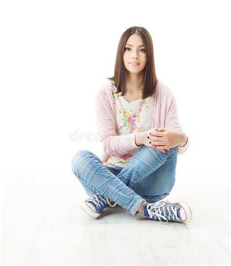 beautiful girl teenager sitting  floor stock photo